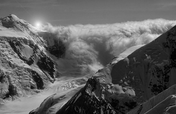 Heavy cloud rolls into an upper pass of Mount McKinley (Denali), near the summit which originates several glaciers. #0434