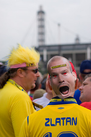 Sweden fans (one with a Freddie Ljunberg mask on the back of his head) outside Köln's stadium, before their match with England.