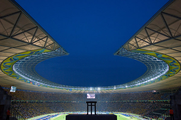 """The famous <a href=""""http://en.wikipedia.org/wiki/Olympic_Stadium,_Berlin#1936._Olympischer_Platz.2C_sportfield_of_the_Reich."""" target=""""blank"""">Olympiastadion</a> (the Olympic Stadium) in Berlin hosts Sweden vs. Paraguay in the opening round of the 2006 World Cup."""