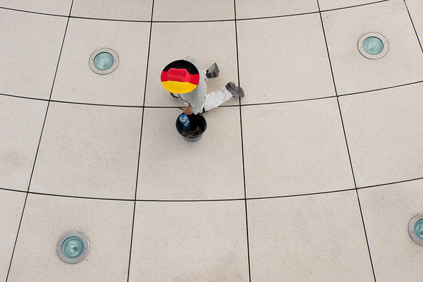 German worker doing maintenance of the floor inside the glass dome of the Bundestag during the World Cup.