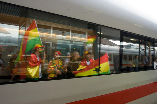 Ghana fans reflected in the windows of an ICE train at Nürnberg station after their win over the USA in the first round of the World Cup.