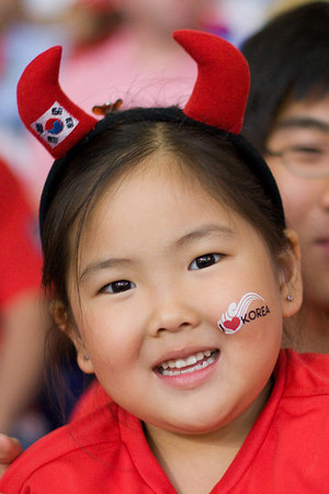 South Korea fan putting on a happy face (and some way cute devil horns) despite her team's 1-0 deficit to Switzerland at half-time in Hannover. (In case you were wondering, the South Korea national soccer team's nickname is the Red Devils.)