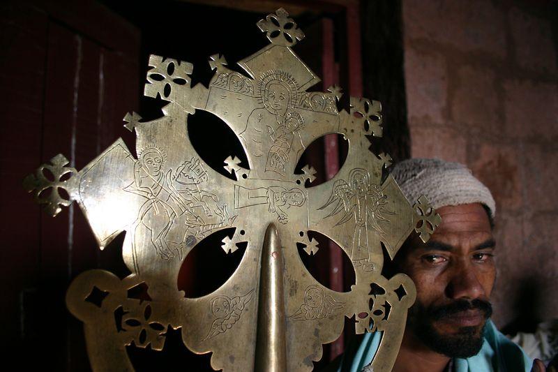 Priest with church cross, Lalibela, Ethiopia