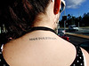 Taken on the bus in Gordon, Canberra, November 2006. It is a real tattoo and she was sitting in the seat in front of me.