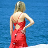 Women modeling a red dress near Bondi Beach, Sydney, February 2007. What is with the two clips?