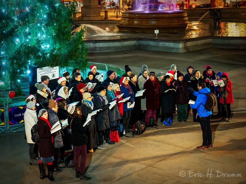 Carolling in Trafalgar Square, London, England