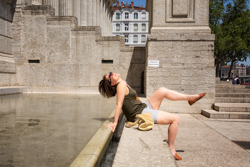 Ffi basking by the water feature at the Palais de justice historique de Lyon