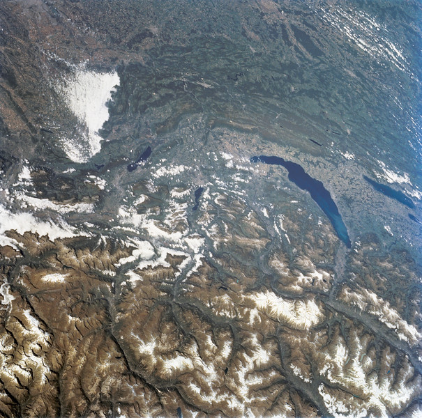 Astronaut Tom Jones: gIt's rare to get a cloud-free pass above the Alps; here is a treat from Space Radar Lab 2. Lake Geneva dominates the center right; Geneva city is at the left, narrow end of the lake. Lake Geneva is fed by the Rhone River, with its spectacular right-angle turn to the east upstream from the lake. At far right center is Lake Neuchatel; Berne is just out of view, to the right. Lac du Bourget is the small lake left of center. Lyons is under the clouds at upper left. Here in early autumn, the snows have not moved into the Alps as yet, but a few high glaciers are still beautifully evident to my crew.<br /> <br /> From NASA: Parts of the Swiss Cantons of Vaud and Valois, the French province of Chablis and parts of northwestern Italy are seen in this widely stretching image photographed from the Space Shuttle Endeavour. Pennine Alps, said to have been created 50 million years ago, have been reshaped by glaciers during Pleistocene. The glaciers created the wide valley of the Rhone River by scourting a pre-existing seam. The fertile Swiss Plateau runs northwest from the shore of Lake Geneva and is visible in lower left. The Franco-Swiss border is located in the center of the lake and follows a mountain divide east of Rhone Valley. Italy lies south of the Rhone.