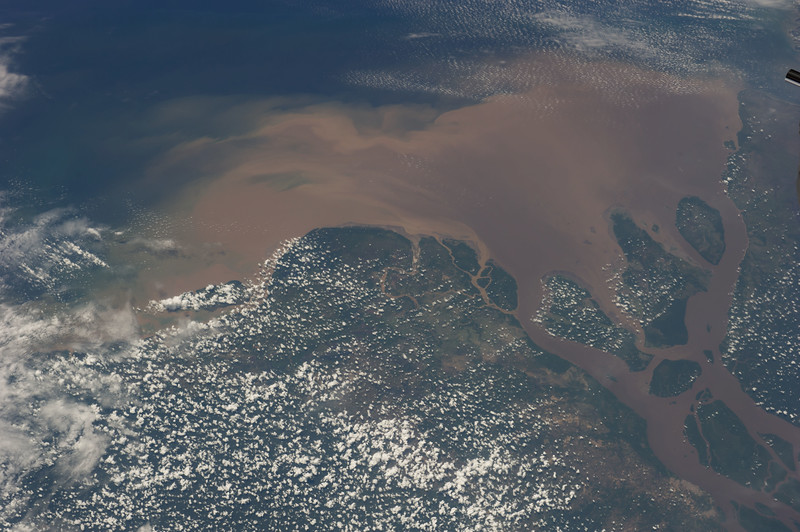 This is the mouth of a river that pushes a 250 mile/400 km plume of fresh water into the ocean, up to 300,000 cubic meters of water *per second* in the rainy season! ISS over South America. (ANSWER: the Amazon River)