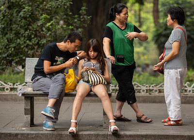 People relax in Gongyuanqian Park in Guangzhou, China.