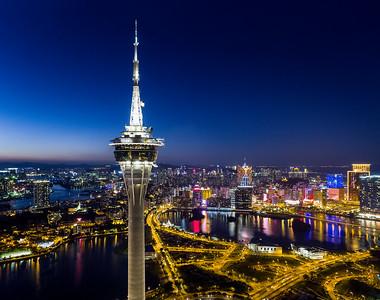 The Macau Tower is illuminated at dusk in Macau, China.