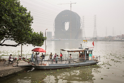 People board a ferry on the Pearl River in Panyu, Guangzhou, Guangdong Province, China.