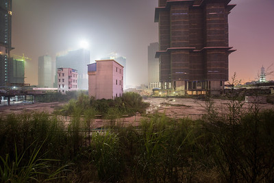 A residential development is under construction near the Canton Fair complex in Pazhou, Haizhu District, Guangzhou, Guangdong Province, China, on Sunday, Oct. 14, 2012. Photographer: Forbes Conrad