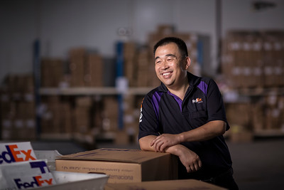 Qing Hua, a FedEX worker,  poses in Shenzhen, China.