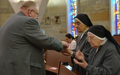 Dn. David offers communion