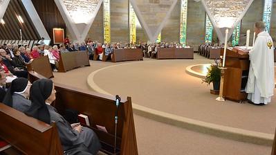 Fr. Jim preaches to a full chapel