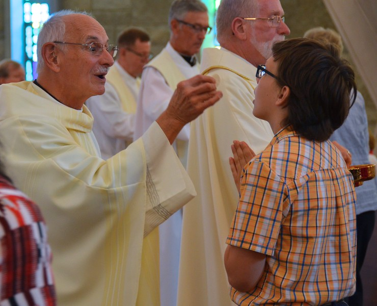 Fr. Dominic shares communion