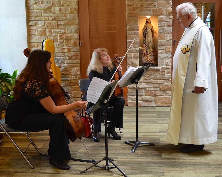 Fr. Ed visits with the musicians