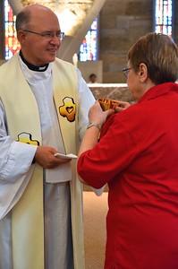 Fr. Steve shares the cup