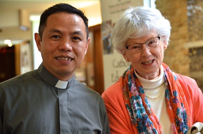 Fr. Quang and one of our visitors
