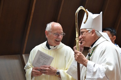 Fr. Dominic and the bishop share a few laughs before the Mass