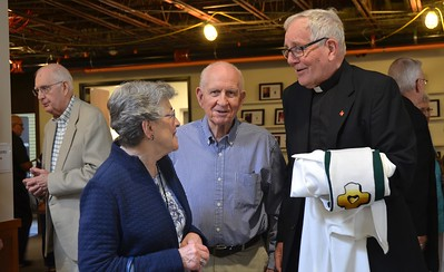 Fr. Jan visits with friends. As you can see, renovations are taking place in the background.