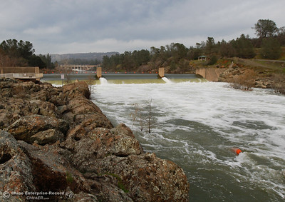 Water fiercely flows over the fish barrier dam and down the Feather River as water is released from Lake Oroville in preparation for the incoming storm January 31, 2017 at the Feather River Fish Hatchery in Oroville, California. (Emily Bertolino -- Enterprise-Record)