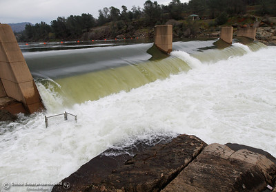 Water fiercely flows over the fish barrier dam as water is released from Lake Oroville in preparation for the incoming storm January 31, 2017 at the Feather River Fish Hatchery in Oroville, California. (Emily Bertolino -- Enterprise-Record)