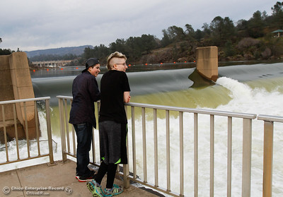 Deja Hartshorn, 18, and Hannah Rains, 17, visit the observation deck at the Feather River Fish Hatchery to witness excess water flowing through the Feather River January 31, 2017 in Oroville, California. (Emily Bertolino -- Enterprise-Record)