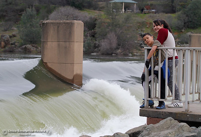 Daymien, 9, and May Saechao, 12, visit the observation deck at the Feather River Fish Hatchery to witness excess water flowing through the Feather River January 31, 2017 in Oroville, California. (Emily Bertolino -- Enterprise-Record)