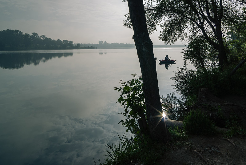 The early bird catches the worm. This is a photograph of Standing Bear Lake during a hazy morning.