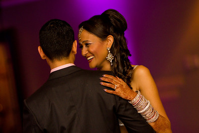 Wedding photo of bride and groom dancing.