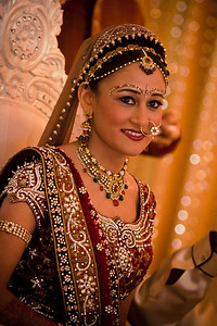 Wedding photo of Indian bride smiling during ceremony.