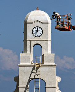 102110 - PALM BEACH - Photo goes with story on Worth Avenue construction.  Photo shows the final touches being applied to the new Palm Beach clock tower. The tower is considered to be the landmark to signify Worth Avenue.   Photo by Tim Stepien