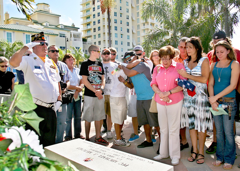 111212 - BOYNTON BEACH - Family and friends of Michael J. Metcalf honor him with an engraved granite bench on Veteran's Day during a memorial service at the Veterans Memorial Park in Boynton Beach. Michael J. Metcalf, an Army private first class, died in April when trying to save four other soldiers while in Afghanistan as part of Operation Enduring Freedom. He was killed when his Hummer hit a roadside bomb.  Photo by Tim Stepien