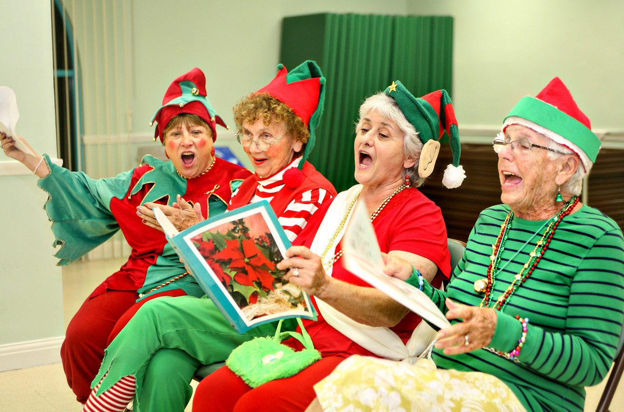 """112210 - BOCA RATON - Elves practice singing Christmas songs during """"elf training"""" at Boca Raton Community Center Monday evening.  (L to R) Claire Riccardi, Roberta Eberling, Loretta Lombardo, and Fran Moran. (EDITOR NOTE: PLEASE CHECK STORY TO MAKE SURE THE WOMAN ON RIGHT, FRAN, IS MENTIONED AS THE 92 YEAR OLD WOMAN.  I MAY HAVE THE LAST TWO WOMENS NAMES REVERSED.  I THINK IT  IS CORRECT THOUGH.  Photo by Tim Stepien"""