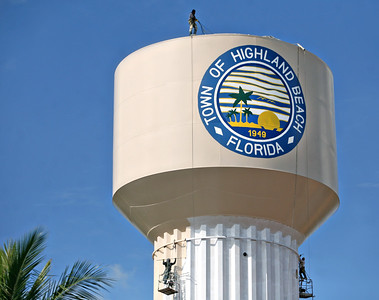 111913 - HIGHLAND BEACH - Workers tackle the extensive job of painting the 500,000-gallon water tower in Highland Beach, FL.  Photo by Tim Stepien
