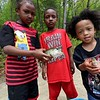 Shaquille Jone, 6, tristan Jones, 6, and Jhorei Jones, 3, show off the fish that Jonathen Jones and Seivily Jones where catching as they fished in Colburns Reservoir at Barrett Park in Leominster on Tuesday, May 15, 2018.  SENTINEL & ENTERPRISE/JOHN LOVE
