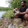 Jonathen Jones and Seivily Jones where trying to catch some fish in Colburns Reservoir at Barrett Park in Leominster on Tuesday, May 15, 2018.  SENTINEL & ENTERPRISE/JOHN LOVE