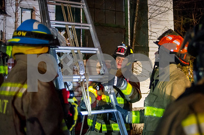 Robert Layman / Staff Photo Clarendon Volunteer Firefighter John Peck talks about the importance of a clove hitch knot at the bottom of the ladder. In the event of the ladder rungs failing, a clove hitch will prevent the collapse of the ladder.