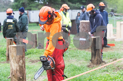 Robert Layman / Staff Photo Cheyanne Lee cranks up her chainsaw before the face cutting.