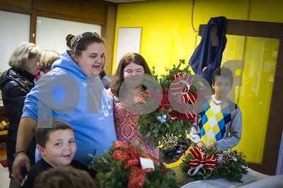 Robert Layman / Staff Photo Members of the Rutland County Boys & Girls Club stand with wreaths they decorated. The wreaths and decorations were supplied by the