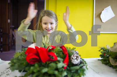 Amaria Bentley, claps in joy after tying her final bow on a wreath she crafted at the Rutland County Boys & Girls Club Wednesday night. Members of the Rutland Garden Club brough the children wreaths and supplies to decorate 17 in total. Bentley is excited to hang it on her door with her sisters.