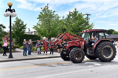 Tammy Carboni-Branchaud drives her late husband Leo's tractor in front of the Rutland criminal courthouse as a crowd cheers following the setencing of Thomas H. Velde, who killed her husband in a fatal hit-and-run crash in 2016. Velde was setenced to 19 years in prison. (Robert Layman / Staff Photo)