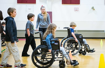 Proctor Elementary School students navigate wheel chairs through cones during a Disability Awareness Assembly Friday March 9, 2018. (Robert Layman / Staff Photo)