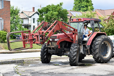 "Tammy Carboni-Branchaud sits in Leo Branchaud, her late husband's 1996 International tractor following the setencing hearing at Rutland criminal court Thursday, July 26, 2018 of Thomas H. Velde, who struck and killed him in a hit and run accident in 2016. In an impactful homage to her husband Carboni-Branchaud drove the tractor from a friend's house to the hearing early this morning, ""because he can't drive it anymore,"" she said. Velde was setenced to 19 years. (Robert Layman / Staff Photo)"