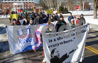 Robert Layman / Staff Photo  Attendees at Green Mountain College's  MLK Celebration: Freedom From Oppression event march down Main Street in Poultney Monday morning, Jan. 15, 2018.