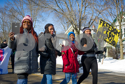 """Robert Layman / Staff Photo Ebony Nyoni, left, co-founder of Black Lives Matter Vermont, walks next to Laura Thompson, march organizer for Green Mountain College's MLK Celebration event """"Freedom From Oppression."""""""