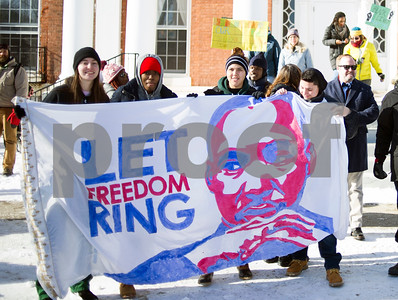 """Robert Layman / Staff Photo  Attendees at Green Mountain College's  MLK Celebration: Freedom From Oppression event hold out a banner with """"Let Freedom Ring"""" and a painting of Dr. Martin Luther King Jr on it Monday, Jan. 15, 2018. GMC hosted a parade which marched down Main Street to St. Raphael's church in observence of Dr. King."""
