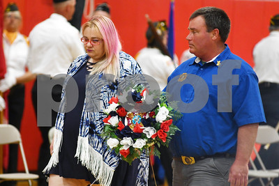 Mickey Young, left, and Dan DeAlba Auxiliary President of Post 648 lay the Memorial Wreath during the ceremony at Rutland High School Monday, May 28, 2018. (Robert Layman / Staff Photo)